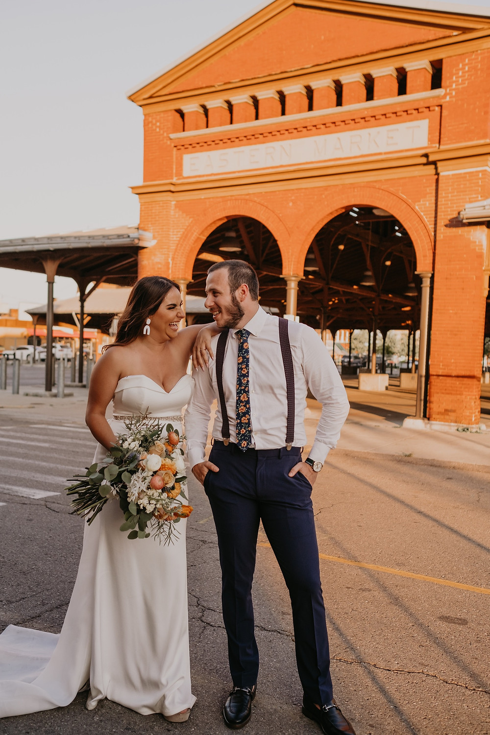 Bride and groom at Eastern Market Detroit pavilion. Photographed by Nicole Leanne Photography.