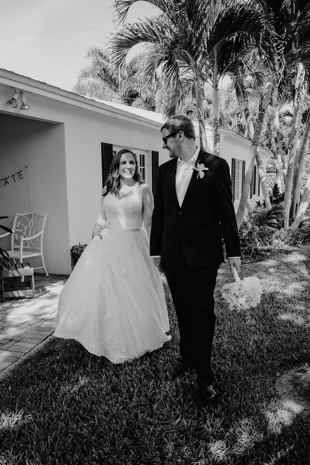 Smiling couple in black and white at wedding