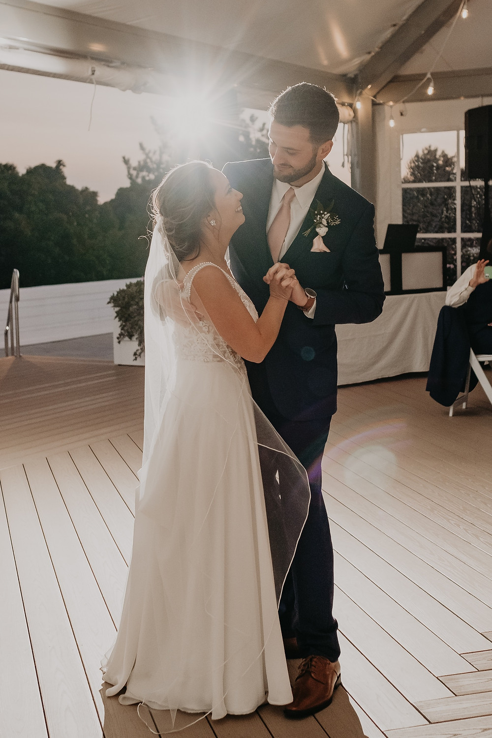 Bride and groom dance together at wedding. Photographed by Nicole Leanne Photography.