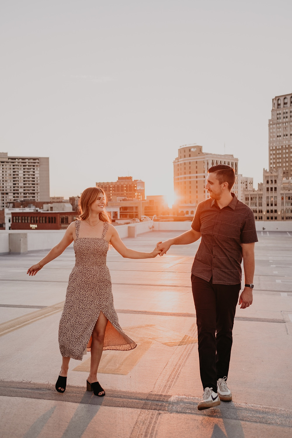 Detroit Rooftop at sunset for engagement photos. Photographed by Nicole Leanne Photography.