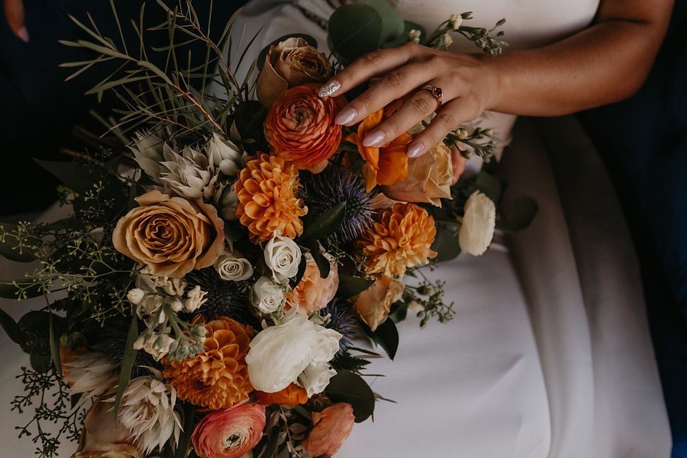 Close up of fall wedding florals by Copper + Sage Collective. Photographed by Nicole Leanne Photography.