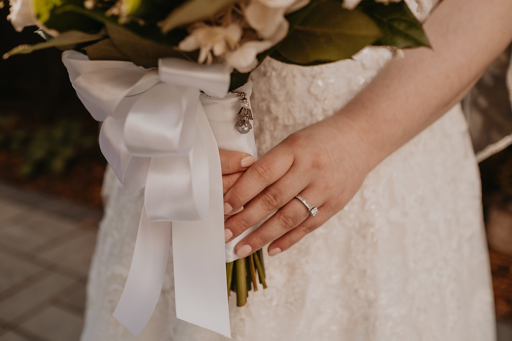 Bride holding wedding bouquet. Photographed by Nicole Leanne Photography.