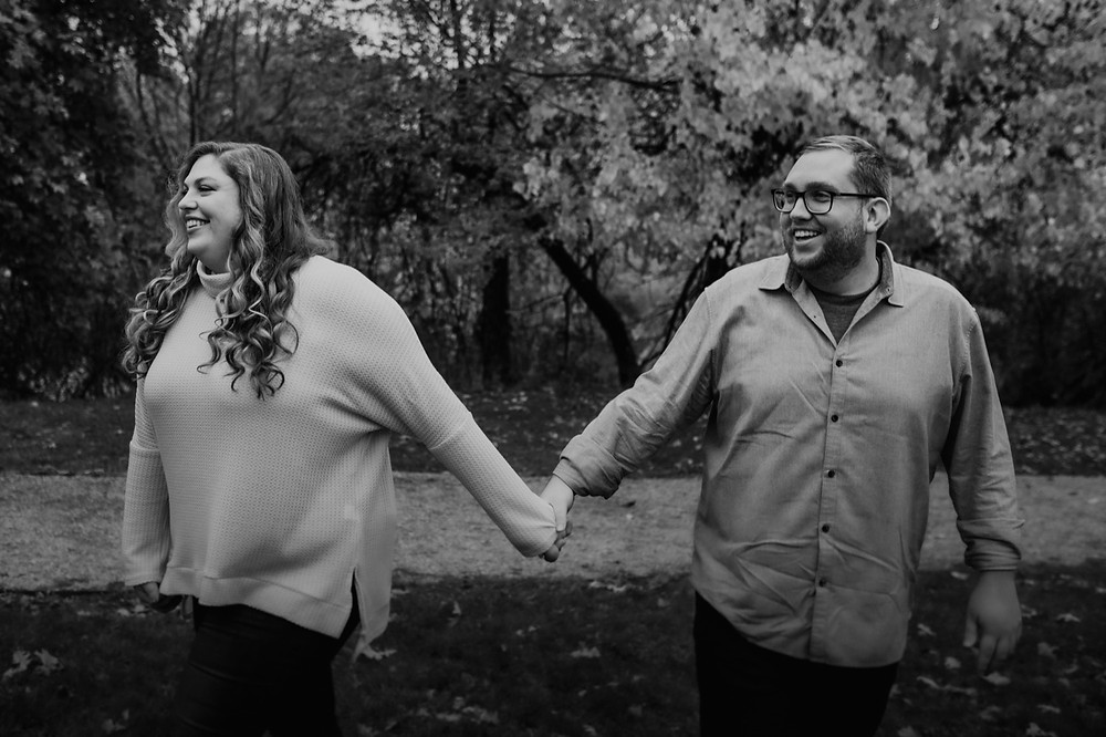 Black and white of couple at engagement session. Photographed by Nicole Leanne Photography.