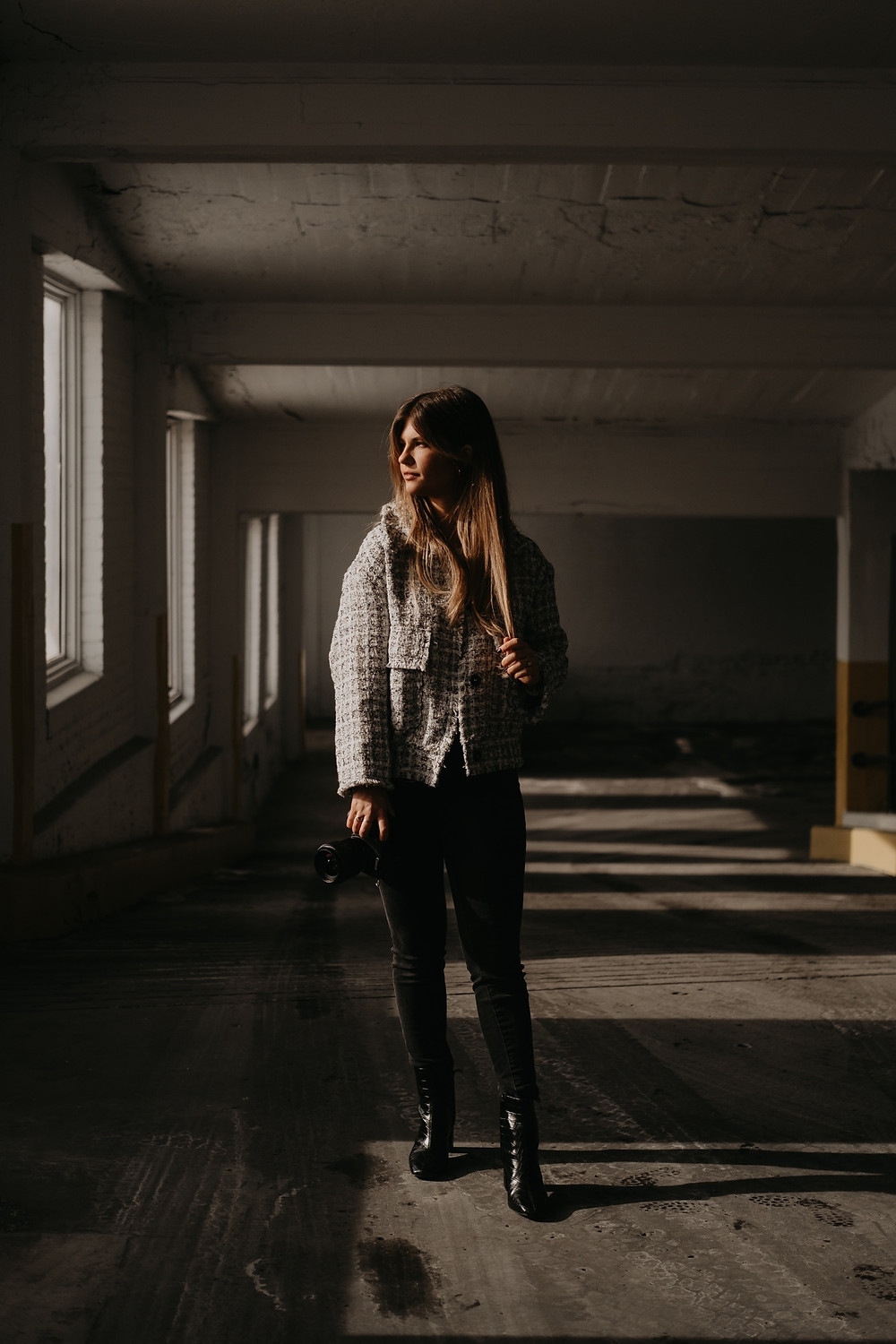 Moody parking garage portrait in Metro Detroit. Photographed by Nicole Leanne Photography.