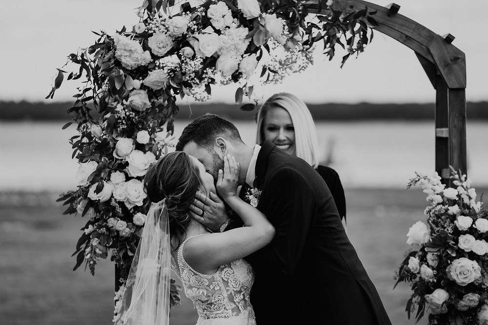First kiss at wedding ceremony. Photographed by Nicole Leanne Photography.