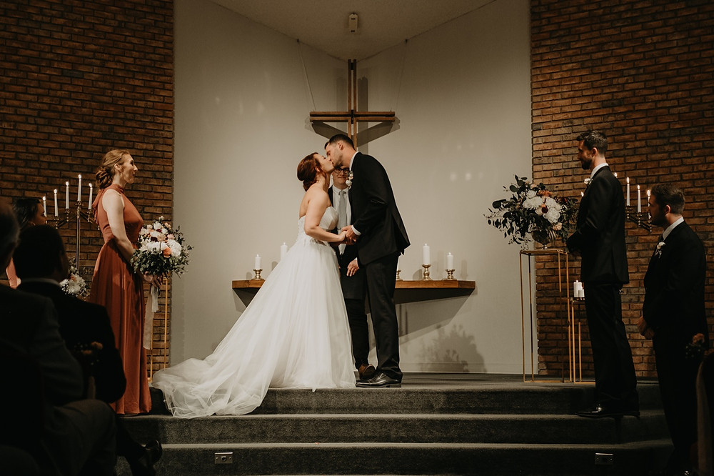 First kiss at church wedding ceremony. Photographed by Nicole Leanne Photography.