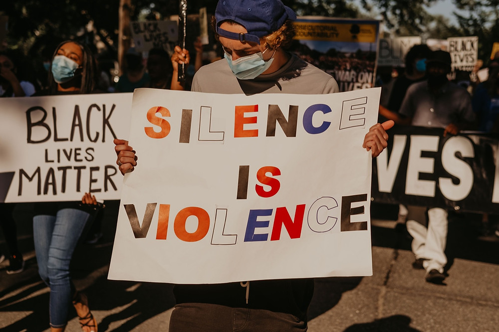 Protest sign Silence is violence