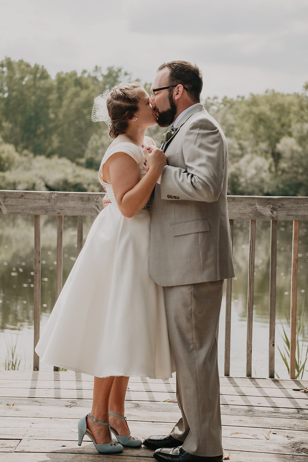 First kiss as husband and wife. Photographed by Nicole Leanne Photography.
