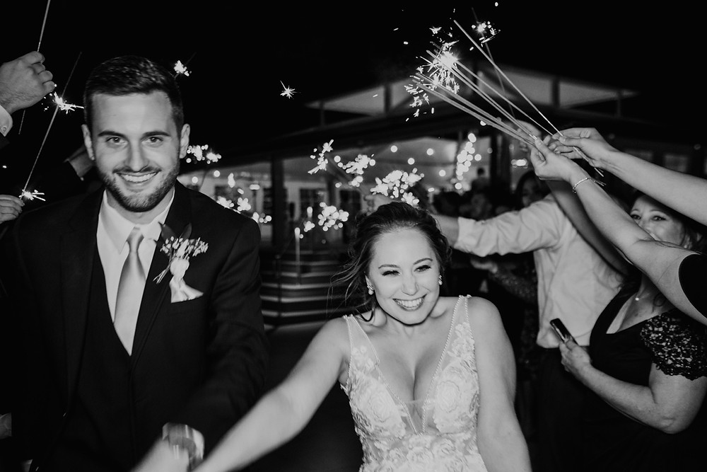 Sparkler send off with bride and groom. Photographed by Nicole Leanne Photography.