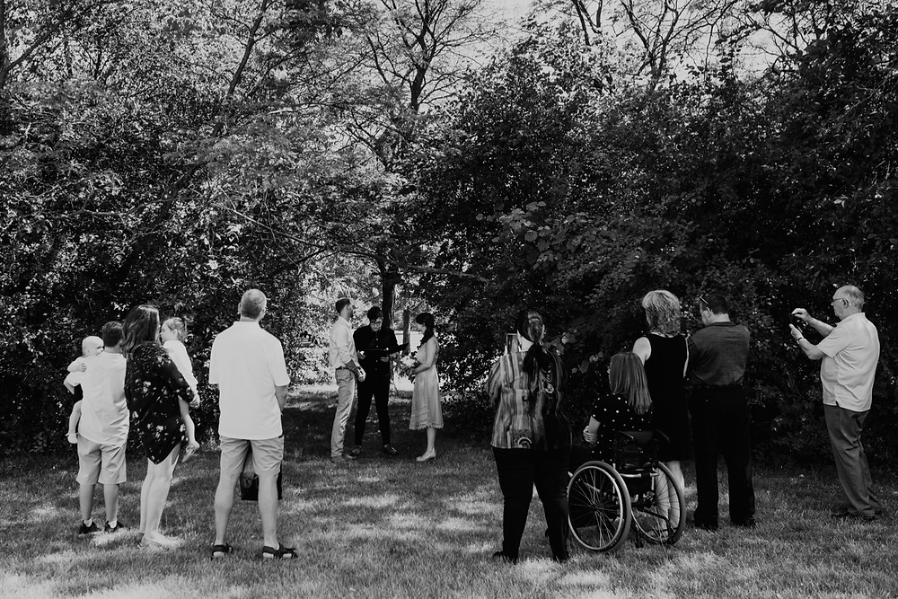 Black and white photo of Heritage Park wedding ceremony. Photographed by Nicole Leanne Photography.