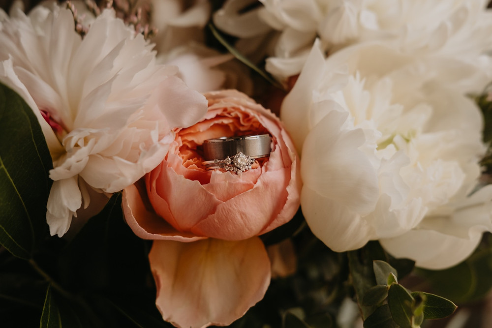 Wedding rings with wedding florals. Photographed by Nicole Leanne Photography.