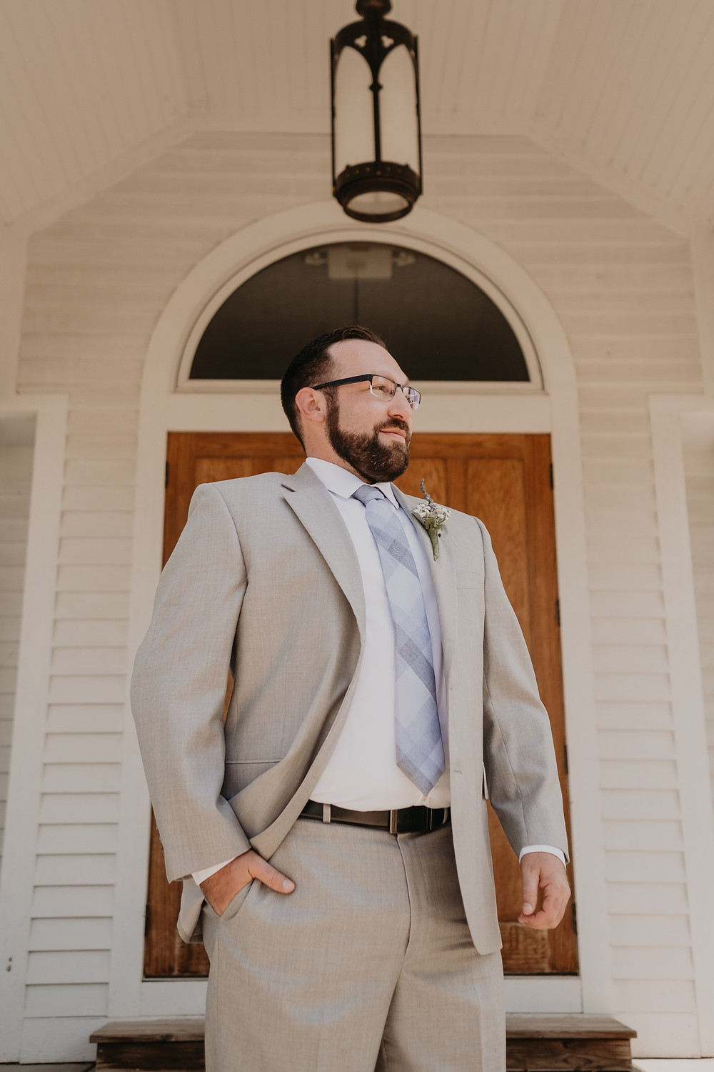 Portrait of groom at Meridian Historical Village. Photographed by Nicole Leanne Photography.
