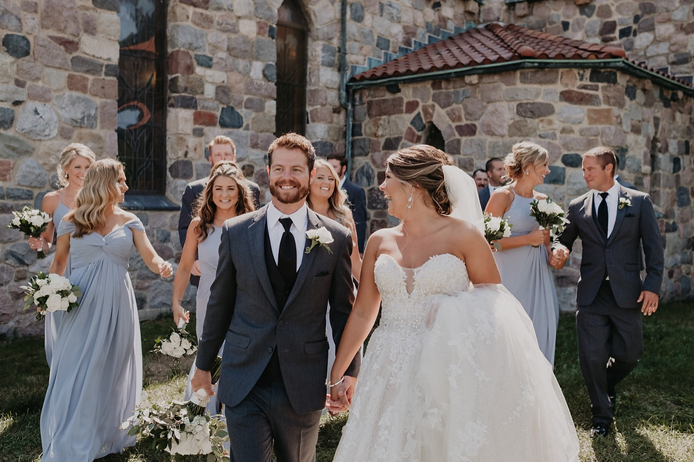 Bride and Groom with wedding party outside St. Joseph's Catholic church. Photographed by Nicole Leanne Photography.