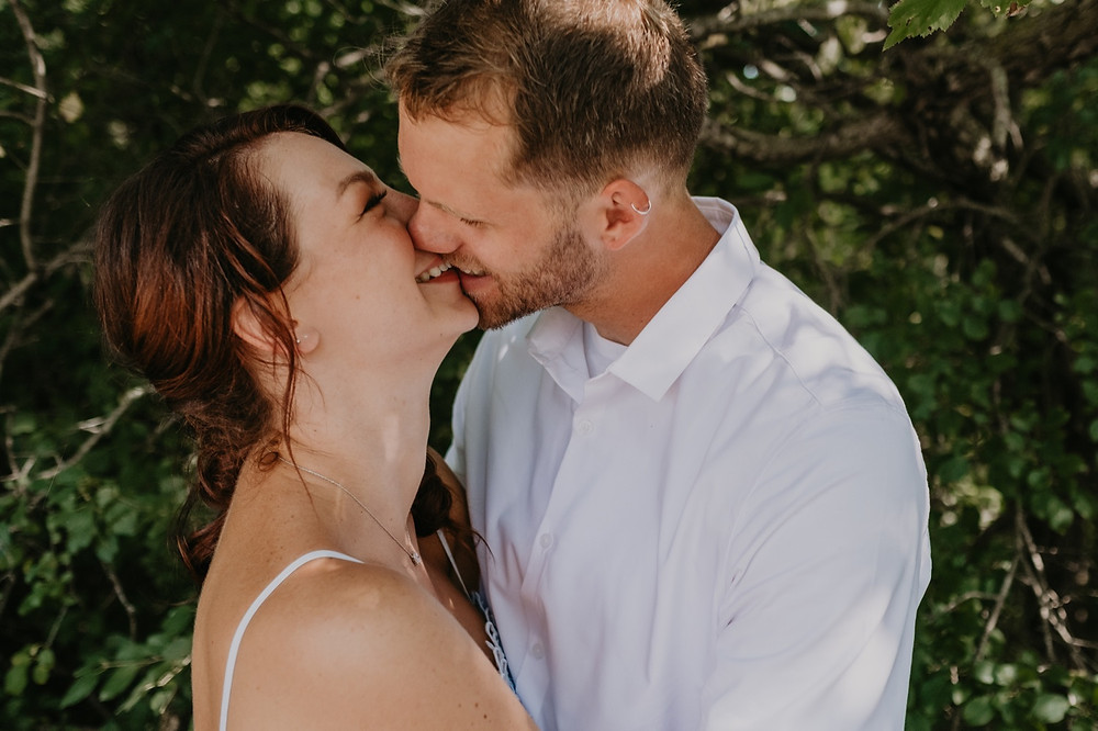 Bride and groom kissing after wedding ceremony at Heritage Park in Metro Detroit. Photographed by Nicole Leanne Photography.
