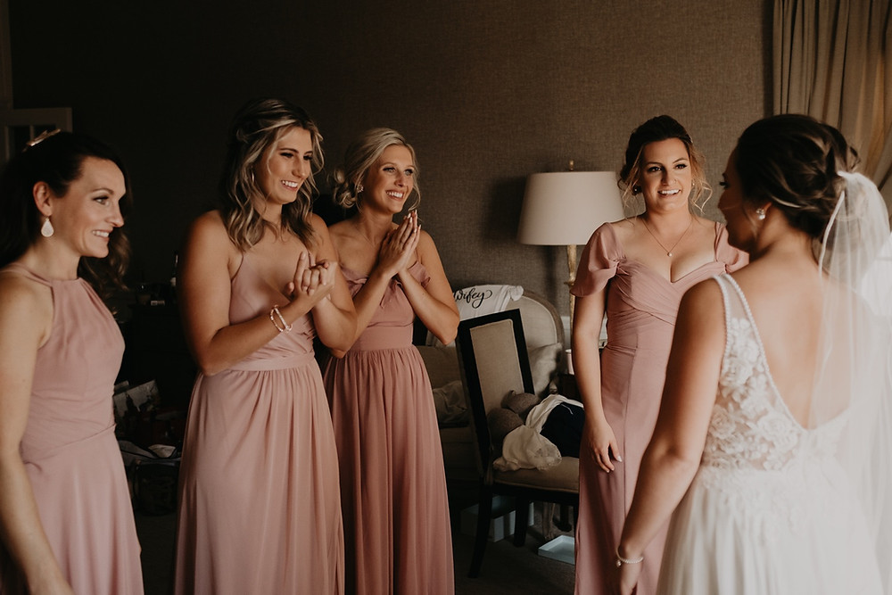 Bridesmaids see bride for first time on wedding day. Photographed by Nicole Leanne Photography.