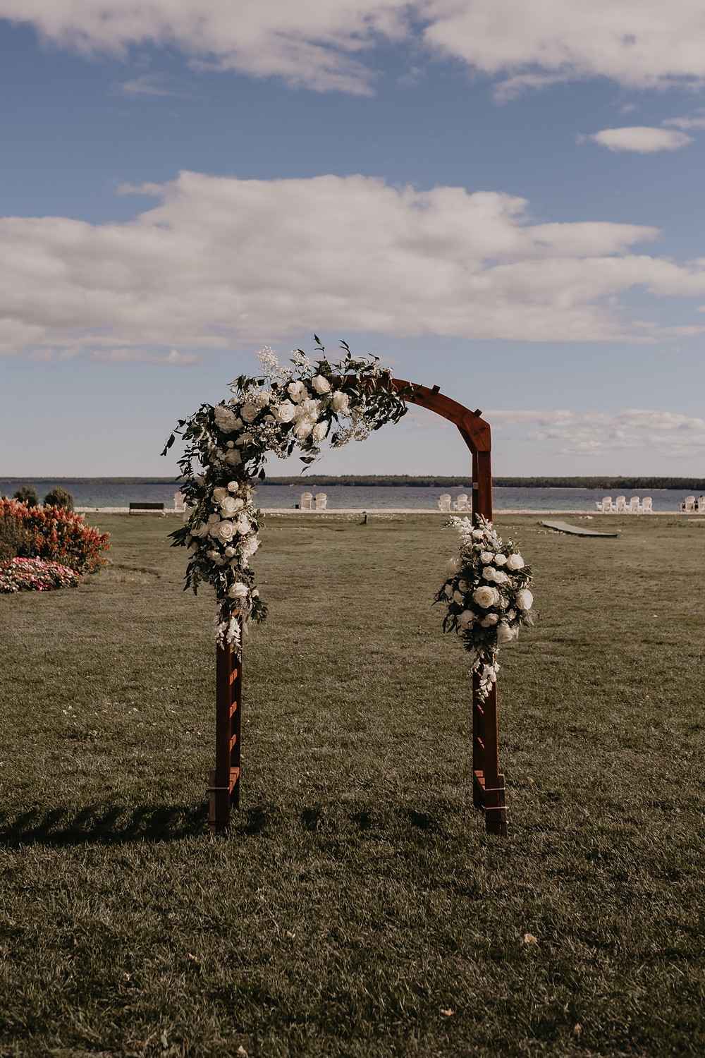 Wedding arch in Mackinac wedding. Photographed by Nicole Leanne Photography.