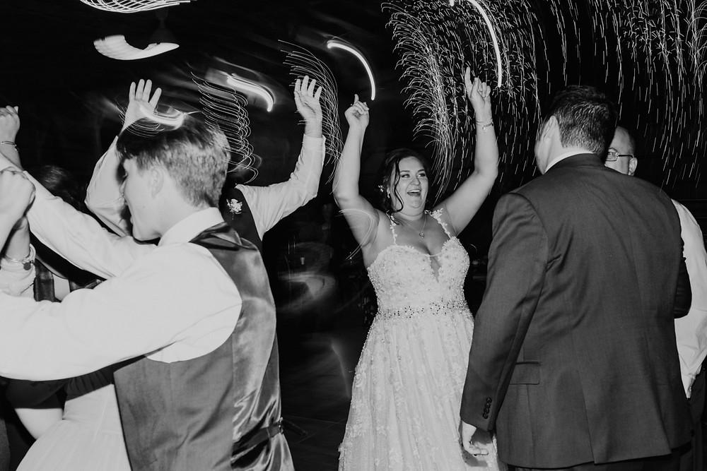 Metro Detroit Bride and guests dancing at barn wedding