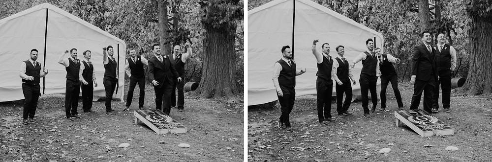 Groom and groomsmen playing corn hole at wedding