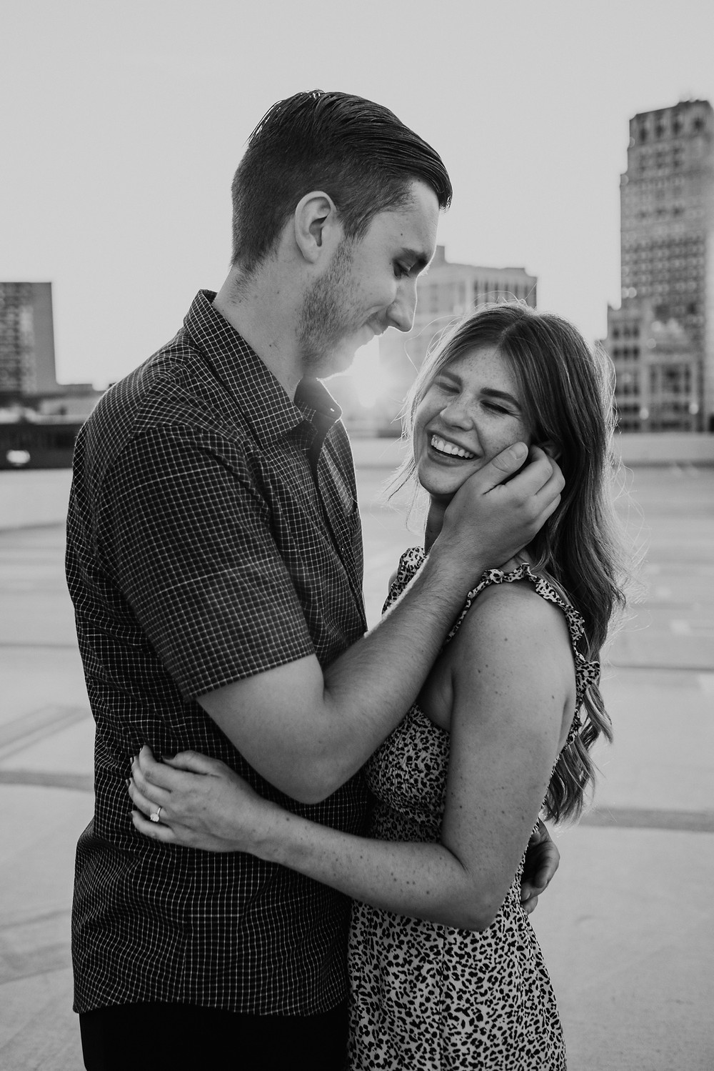 Black and white engagement portrait of couple smiling. Photographed by Nicole Leanne Photography.