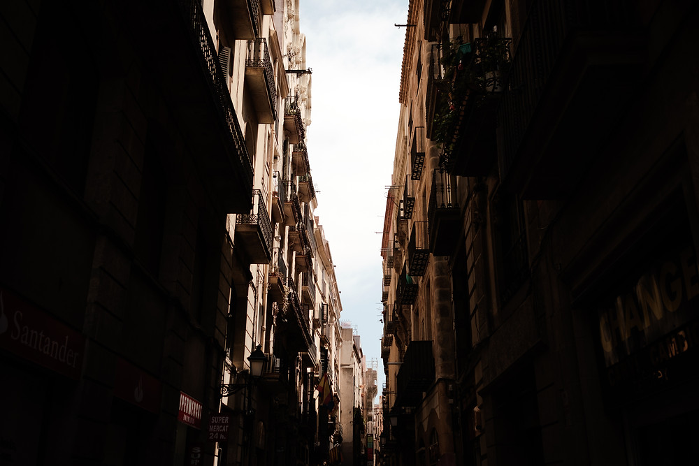 View of Barcelona buildings from an alley. Photographed by Nicole Leanne Photography.