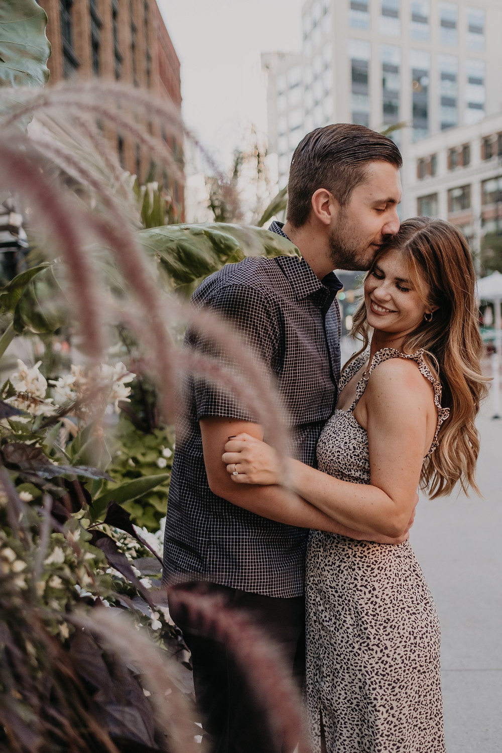 Detroit engagement photos with building and flowers. Photographed by Nicole Leanne Photography.