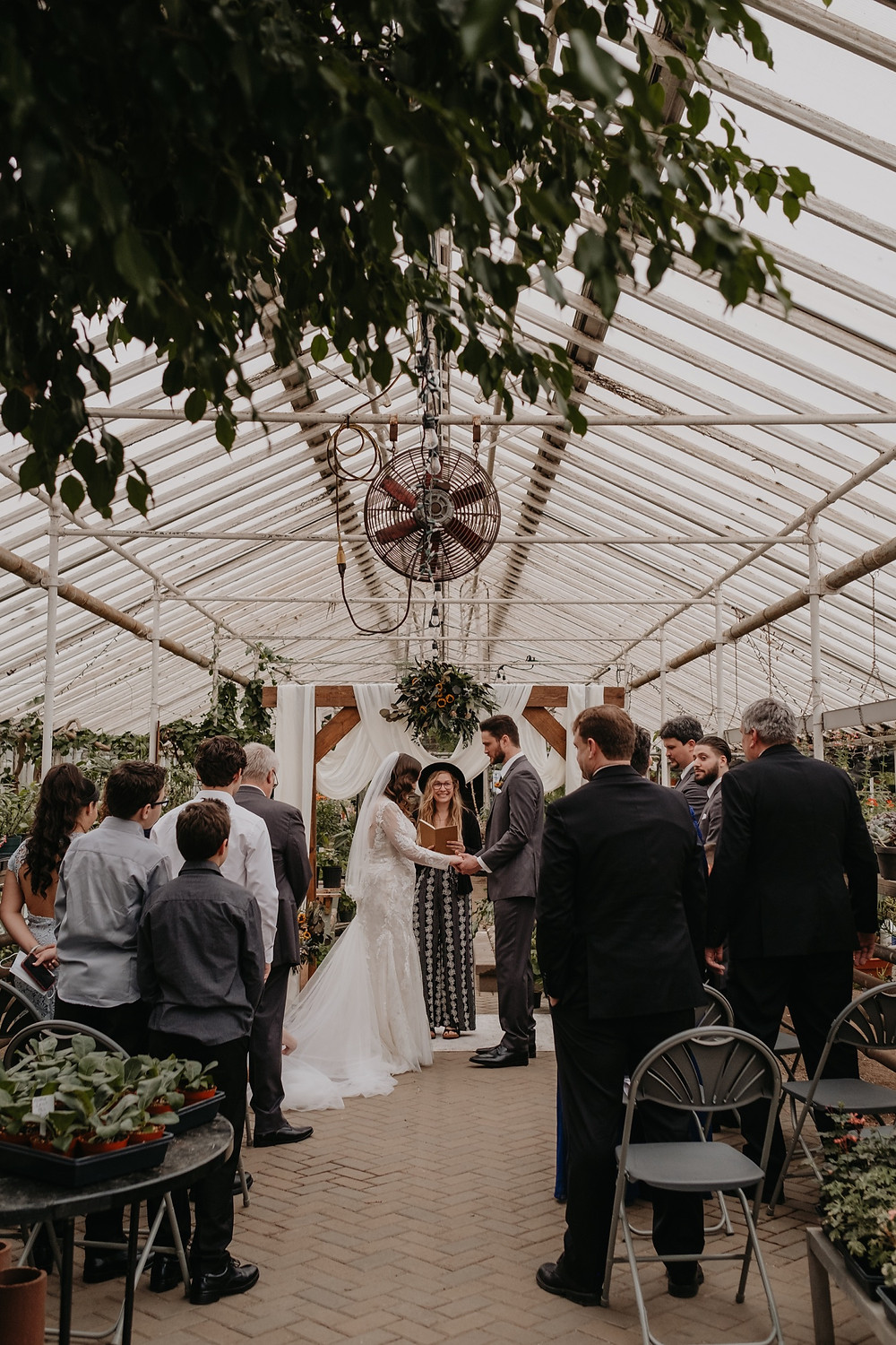 Graye's Greenhouse wedding ceremony in Metro Detroit. Photographed by Nicole Leanne Photography.