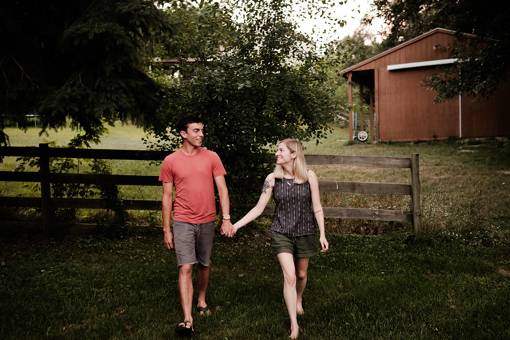 couple walking, barnyard