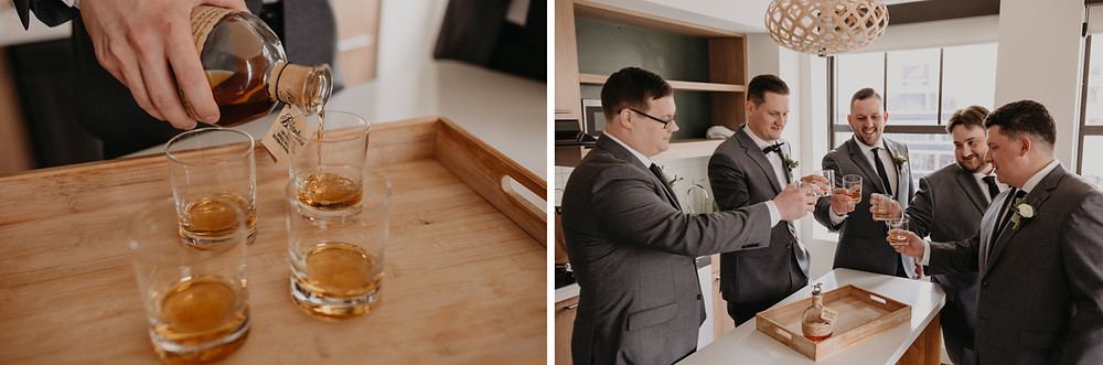 Groom and groomsmen cheers with whiskey before wedding ceremony. Photographed by Nicole Leanne Photography.