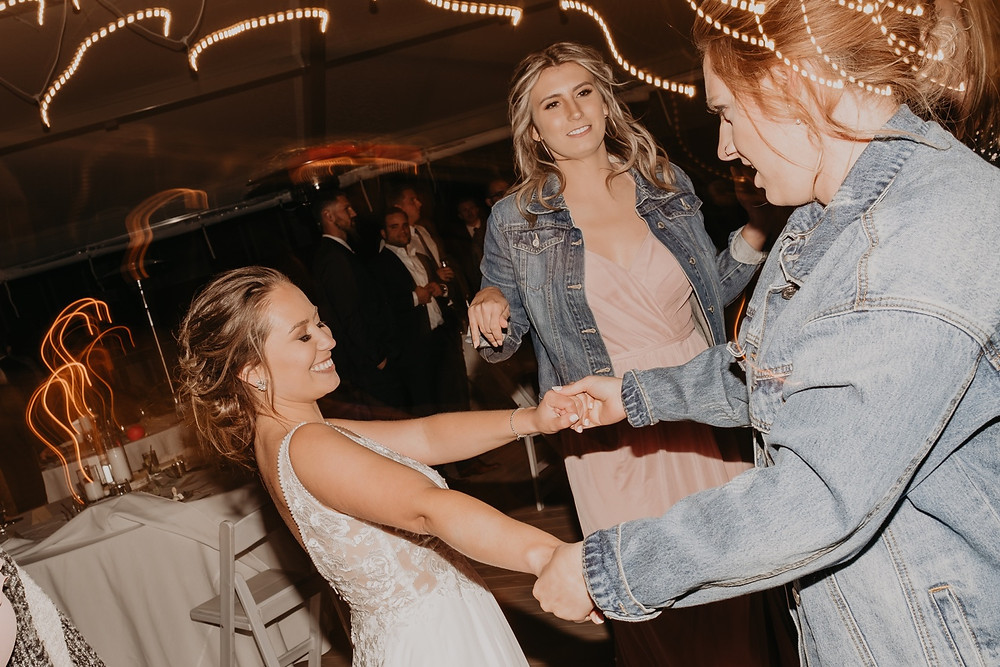 Family and guests dance at wedding. Photographed by Nicole Leanne Photography.