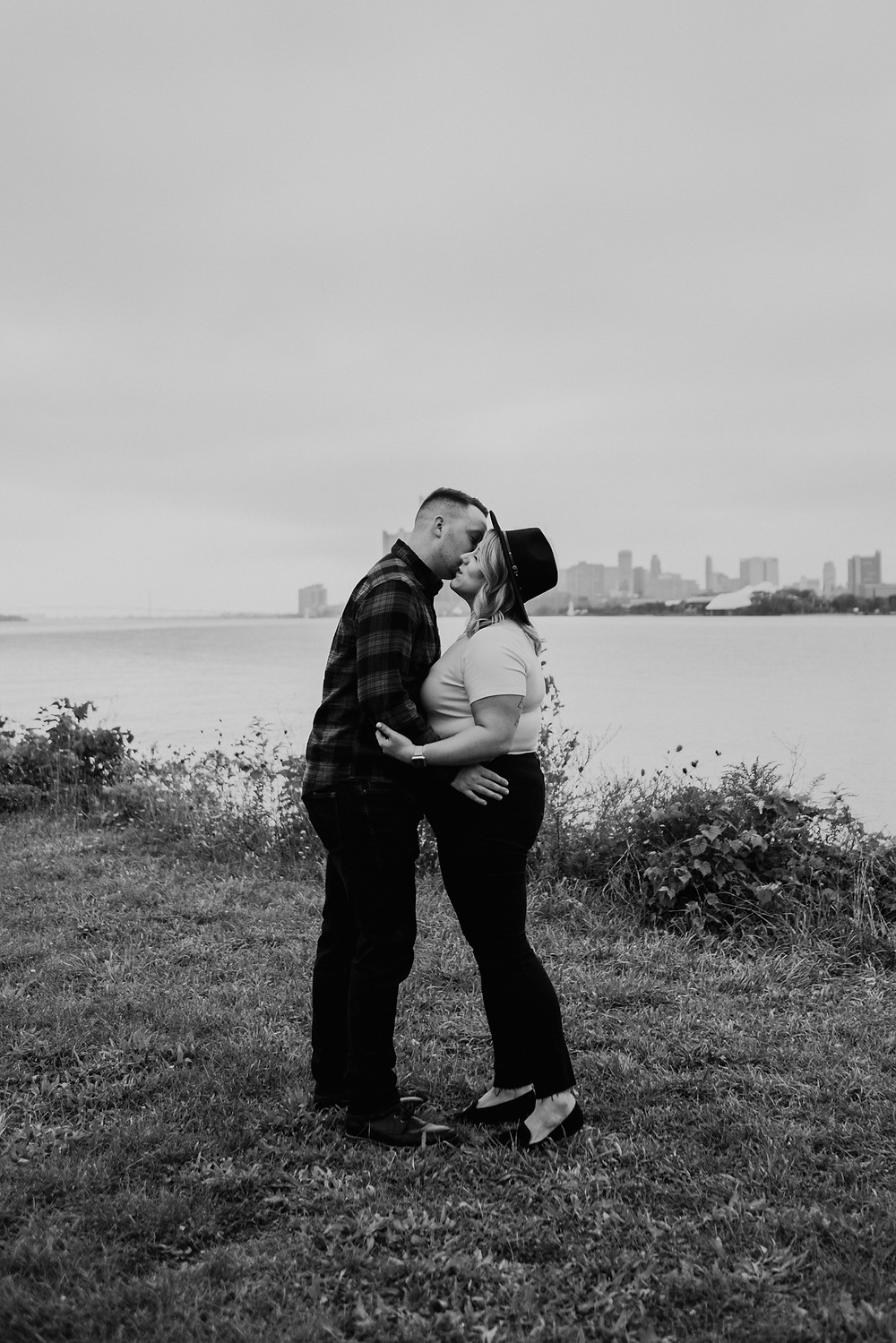 Black and white engagement photos at Detroit River. Photographed by Nicole Leanne Photography.