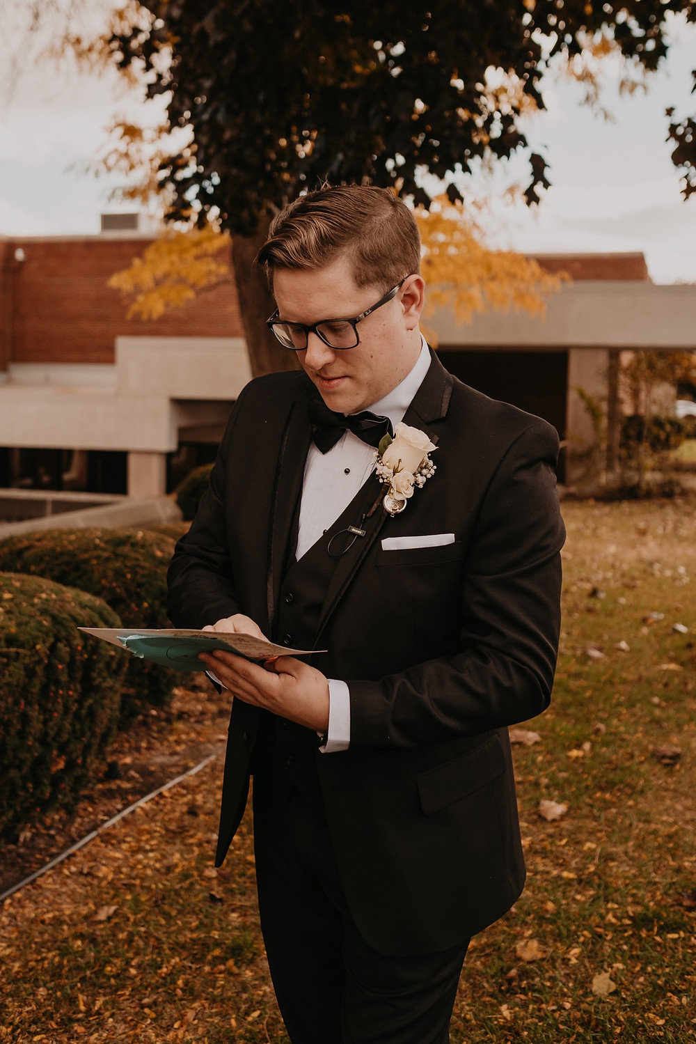 Groom reading letter from bride. Photographed by Nicole Leanne Photography.