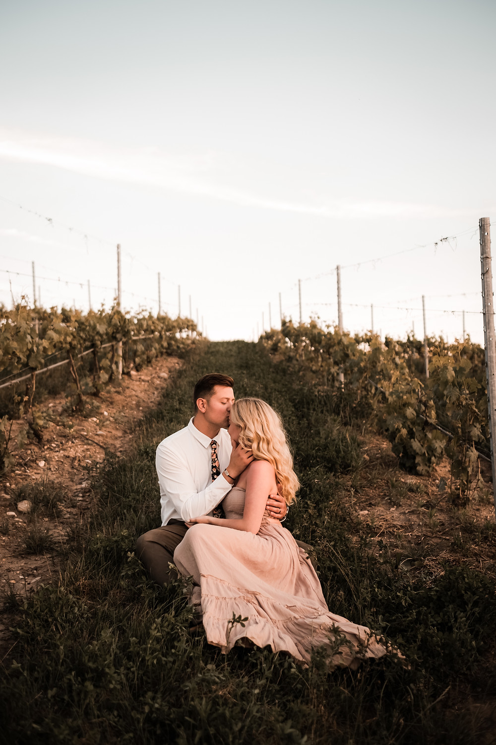 Engagement photo session with couple in a vineyard