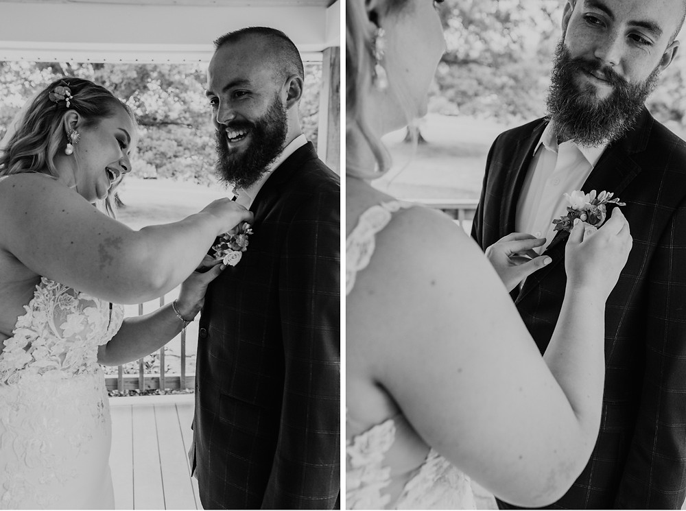 Bride pinning boutonniere on groom for wedding day. Photographed by Nicole Leanne Photography.
