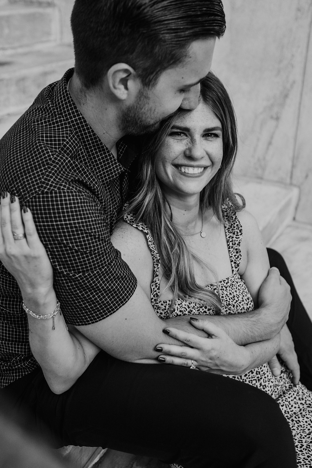 Close up of couple sitting on steps for engagement photos. Photographed by Nicole Leanne Photography.