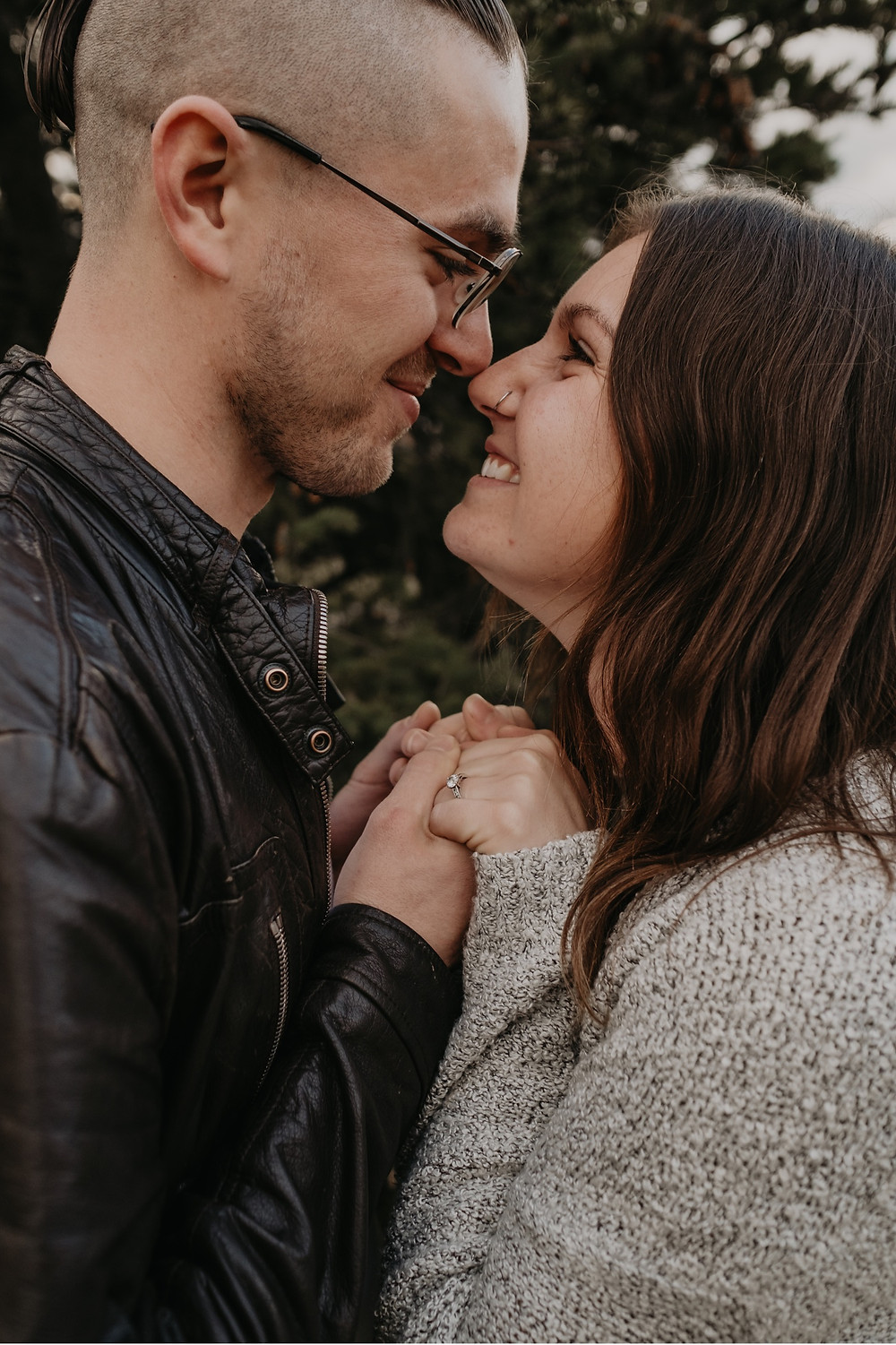 Couple touching noses during engagement photos. Photographed by Nicole Leanne Photography.