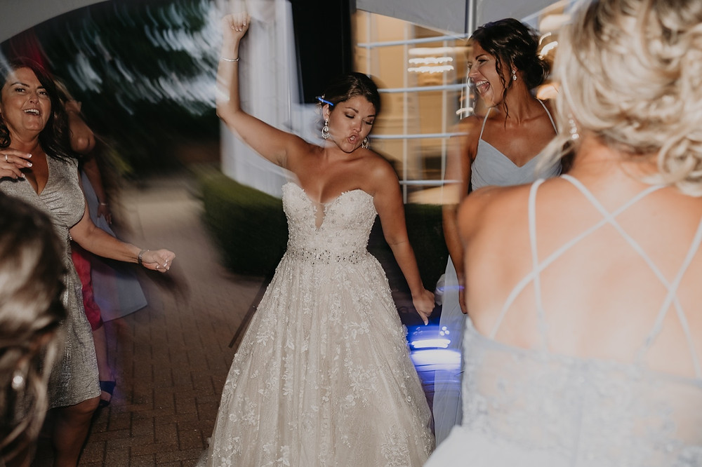 Wedding reception dancing in Metro Detroit. Photographed by Nicole Leanne Photography.