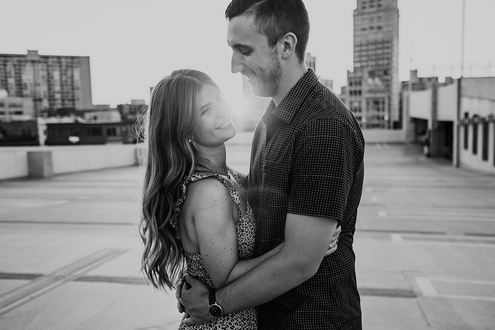 Black and white sunset engagement photos at Detroit parking garage. Photographed by Nicole Leanne Photography.