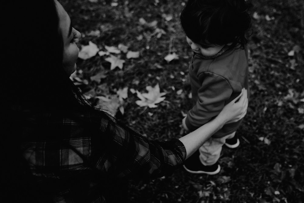 embracing child, black and white