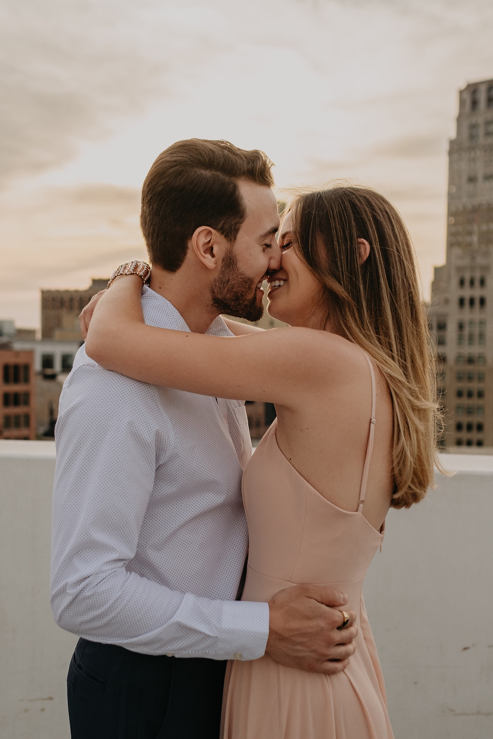 Rooftop engagement photos in Detroit. Photographed by Nicole Leanne Photography.