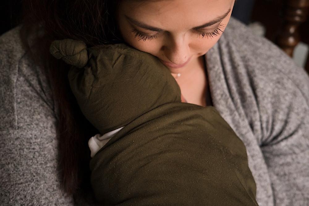 close up mother holding newborn