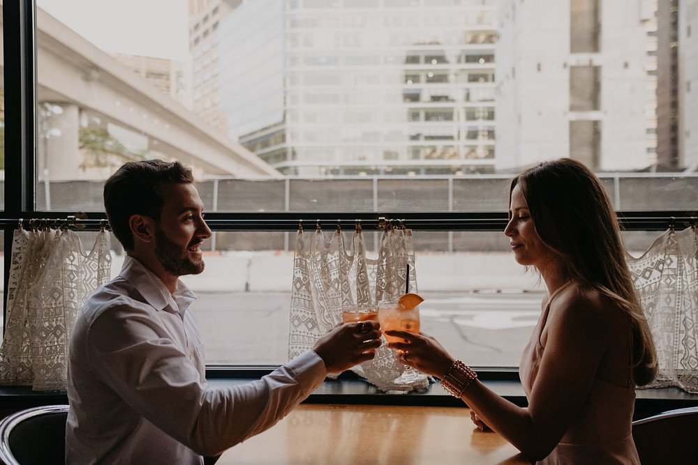 Couple sharing drinks at Queens bar in Detroit. Photographed by Nicole Leanne Photography.