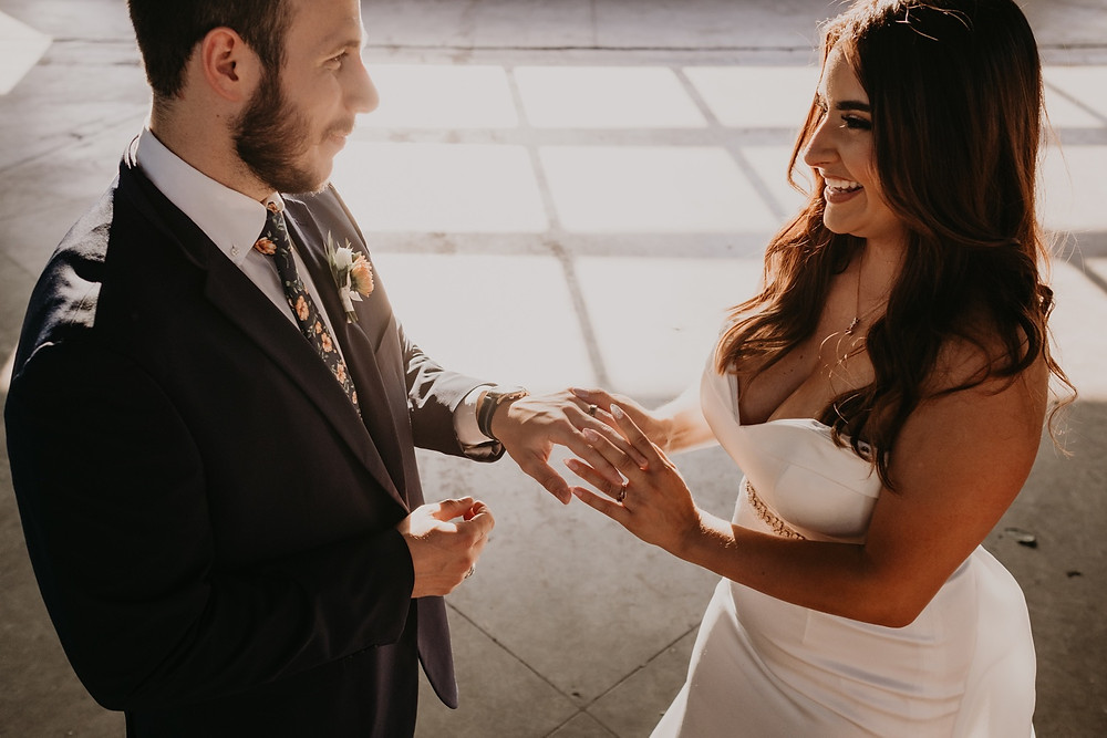 Ring exchange at Eastern Market Detroit wedding. Photographed by Nicole Leanne Photography.