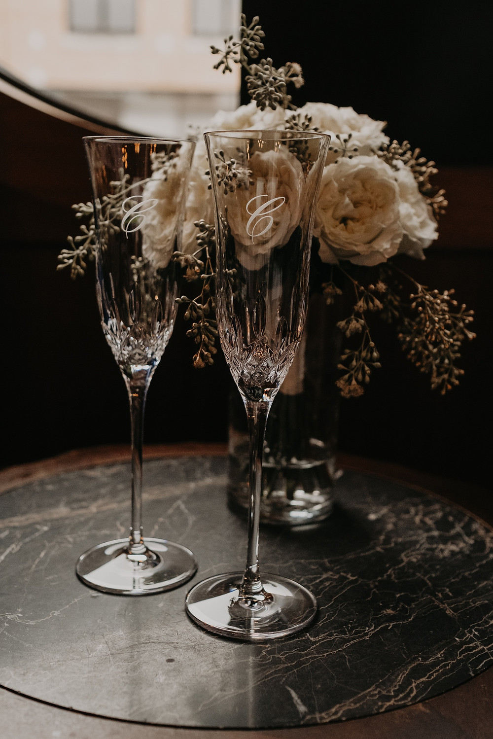 Wedding champagne flutes personalized for couple. Photographed by Nicole Leanne Photography.