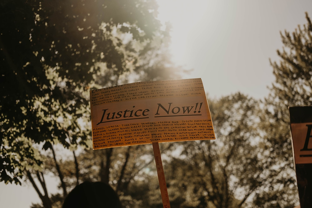 Justice Now protest sign