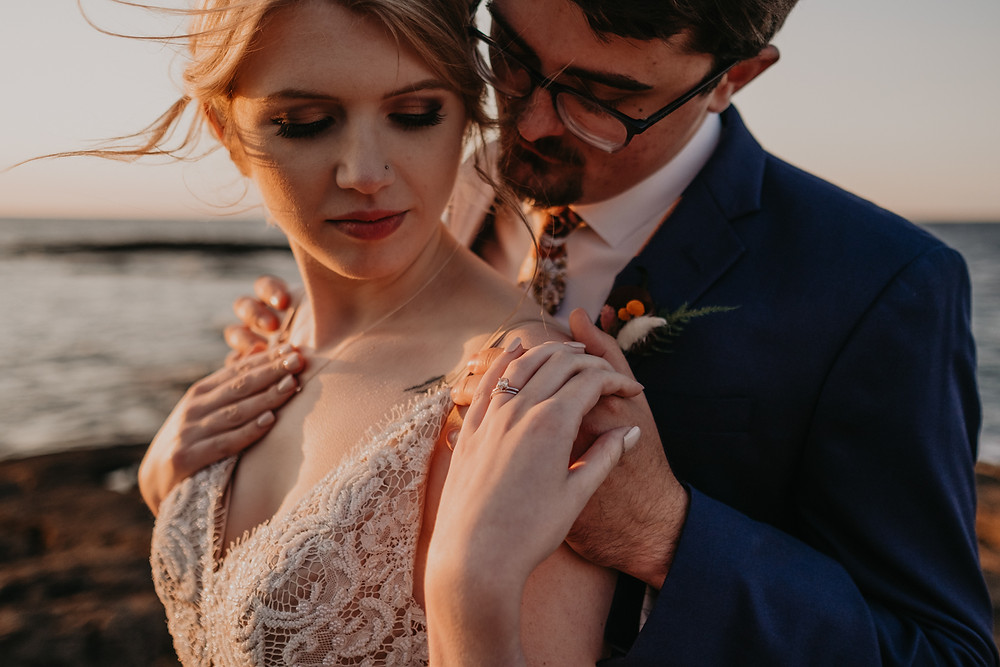 Sunset elopement wedding at Mission Point in Mackinac City, Michigan. Photography by Nicole Leanne Photography