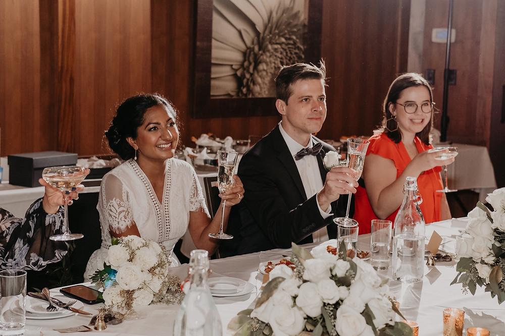 Wedding toast at intimate reception. Photographed by Nicole Leanne Photography.