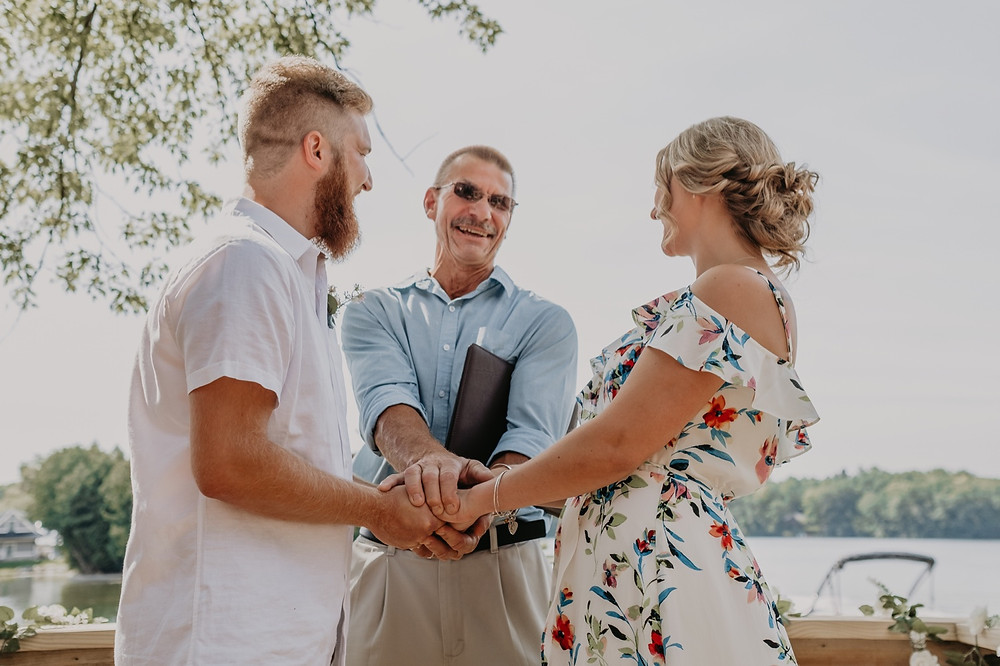 Intimate wedding ceremony in backyard in Metro Detroit. Photographed by Nicole Leanne Photography.