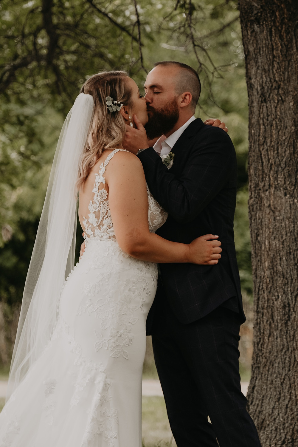 First kiss as married couple at Metro Detroit wedding ceremony. Photographed by Nicole Leanne Photography.