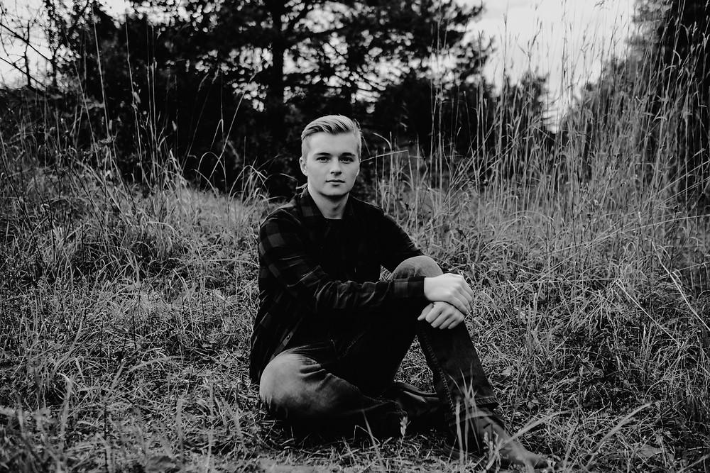 sitting in tall grass, high school senior
