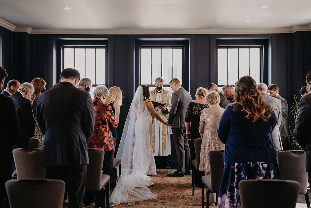 Wedding ceremony at The Monarch Club in Detroit Michigan. Photographed by Nicole Leanne Photography.